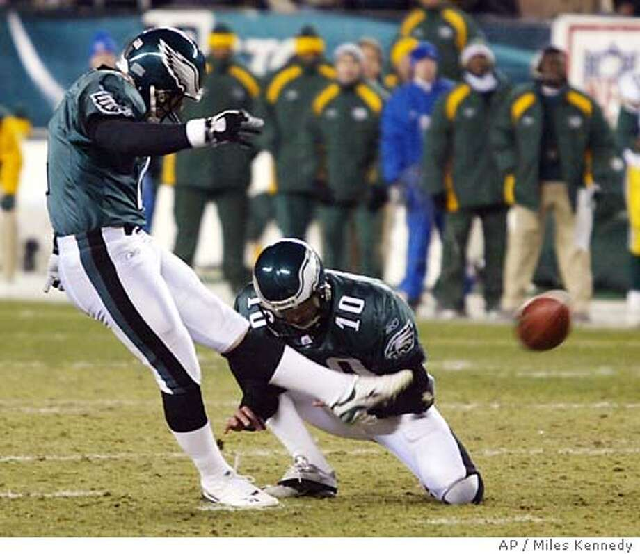 Philadelphia Eagles kicker David Akers kicks the game-tying field goal in the final seconds of the fourth quarter against the Green Bay Packers during their NFC playoff game Sunday, Jan. 11, 2004, in Philadelphia. Eagles Koy Detmer holds. (AP Photo/Miles Kennedy) Photo: MILES KENNEDY