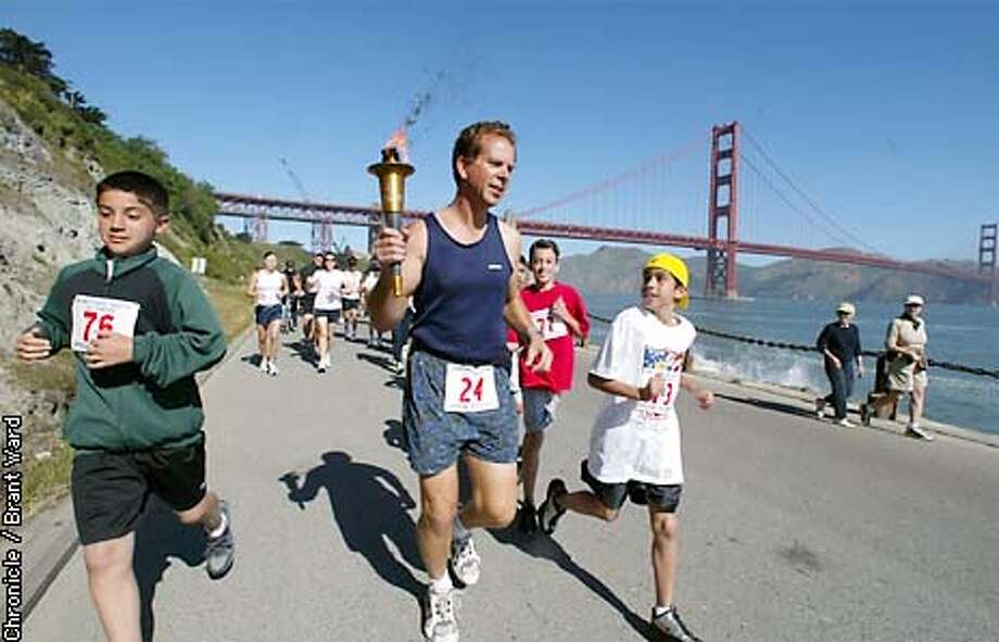 A group of San Francisco police and local youngsters began the torch run for this years Special Olympics near Fort Point in the Presidio. By Brant Ward/Chronicle Photo: BRANT WARD