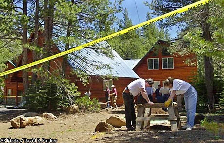 Investigators seach the front yard of a home in Truckee, Calif., owned by defrocked priest and accused child molester Stephen Kiesle on Wednesday, June 5, 2002. Cadavar-sniffing dogs had indicated earlier that something might be buried at the home. Nothing had been found by mid-afternoon. Police were searching for a possible connection to the widely publicized disappearance of Amber Swartz in 1988. (AP Photo/Reno Gazette-Journal, David B. Parker) Photo: DAVID B. PARKER