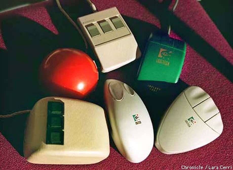 "Mice through thte ages: The evolution of the mouse includes a 1968 model by ""Father of the Mouse"" Doug Engelbart (lower left). From that evolved Logitech devices including (clockwise) a red 1981 model; a simple square in 1985; the green 1989 model; and finally the 1992 and 1996 wireless mice. Photo: LARA CERRI"