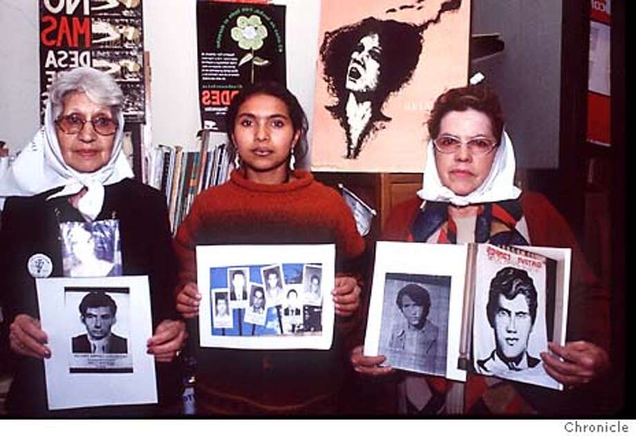 """Adriana Quitero (center) of Colombia holds a photo of relatives who have disappeared in Colombia's civil war. She is flanked by Mirta Acuna de Baravalle (right) and an unidentified Argentine mother, who hold photos of relatives who disappeared during Argentina's """"dirty war"""" between 1976 and 1983. Photo by Camilo George, special to the Chronicle"""