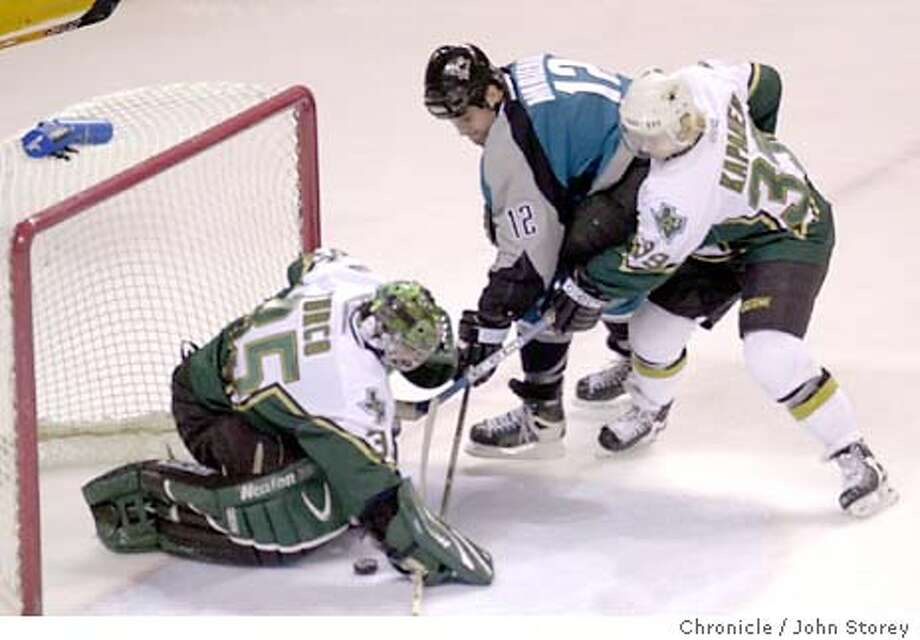 The Sharks vs, the Dallas Stars at the HP Pavillion.  1/13/04 in San Jose. Patrick marleau of the Sharks (12) can't quite get the puck Stars goalie Marty Turco as Niko Kapanen (39) defends for the Stars. John Storey / The Chronicle Photo: John Storey