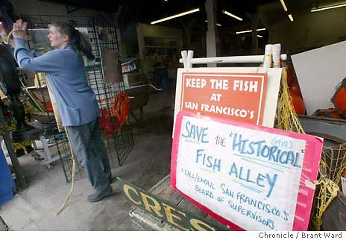 wharf001_bw.jpg A family involved in the wholesale fish market has won a case involving some historic buildings along Fisherman's Wharf's fish alley. They won a judgement against the San Francisco Port providing $4 million to rebuild their old warehouse. Here Angela Cincotta, one of the women in the lawsuit closes up her fish market on Jefferson Street which features signs calling for the saving of the historic area. 1/11/04 in San Francisco Brant Ward / The Chronicle