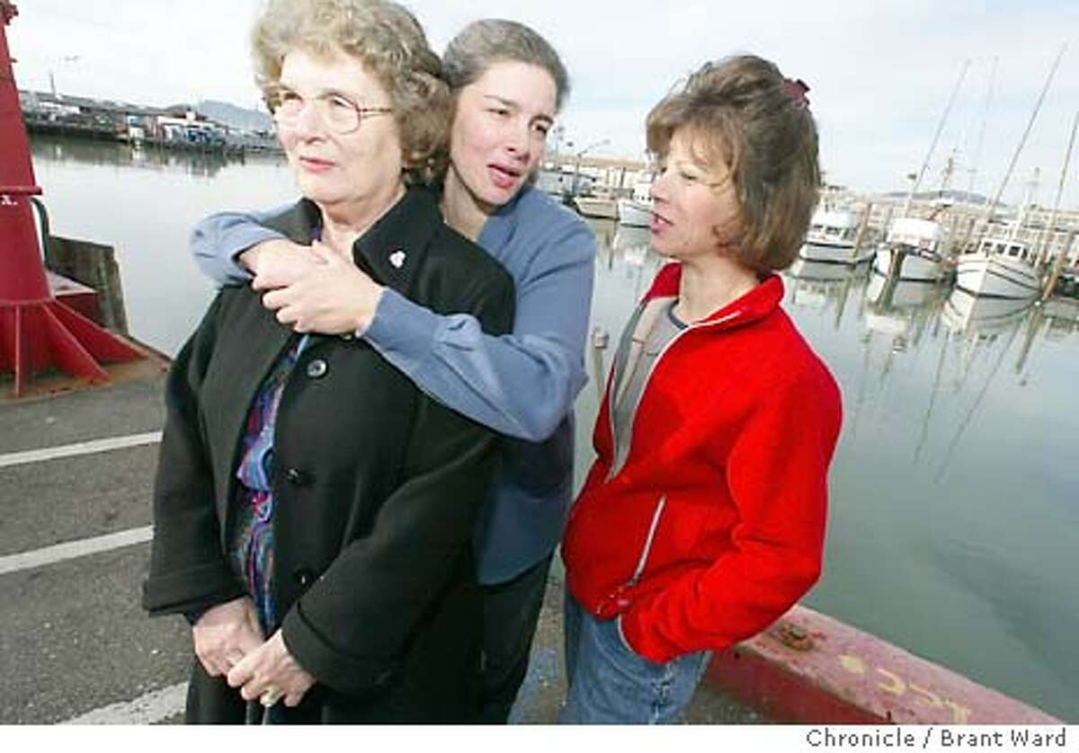 A family involved in the wholesale fish market has won a case involving some historic buildings along Fisherman's Wharf's fish alley. They won a judgement against the San Francisco Port providing $4 million to rebuild their old warehouse. Stephanie Cincotta, in black coat, is surrounded by her daughters--Angela Cincotta, left, and Annette Traverso, right. They stand next to the small pier they unload fish from boats. 1/11/04 in San Francisco Brant Ward / The Chronicle MANDATORY CREDIT FOR PHOTOG AND SF CHRONICLE/ -MAGS OUT