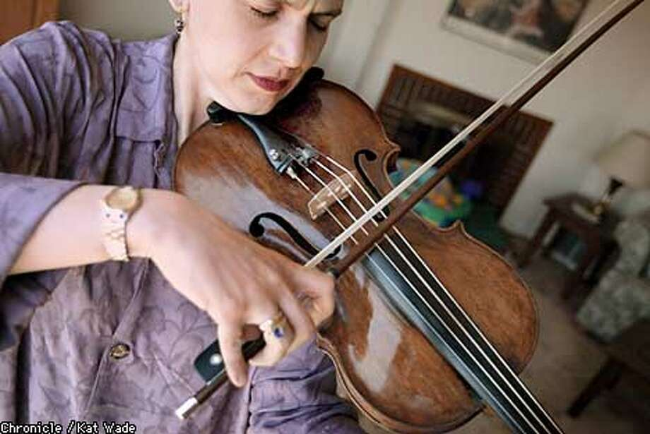 "San Jose violist Kristen Linfante, who lives in San Francisco, says the bankruptcy has ""taken its toll financially and emotionally."" Chronicle photo by Kat Wade"