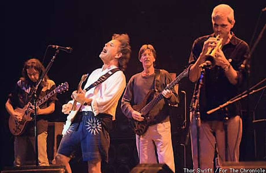 from left: Young Rich Robinson of the Black Crows, Bob Weir (singing), Phil Lesch, horn player is unidentified perform during the eternal jam closing the show. BY THOR SWIFT/FOR THE CHRONICLE Photo: THOR SWIFT