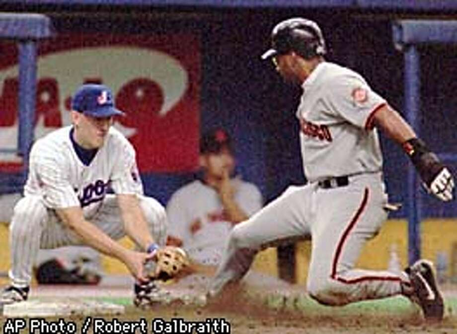 San Francisco Giants Jose Vizcaino, right, is out at third on an attemted steal as Montreal Expos Doug Strange makes the tag during afternoon action in Montreal, Sunday, Aug. 10, 1997. Expos catcher Chris Widger made the throw. (AP Photo/Robert Galbraith) Photo: ROBERT GALBRAITH