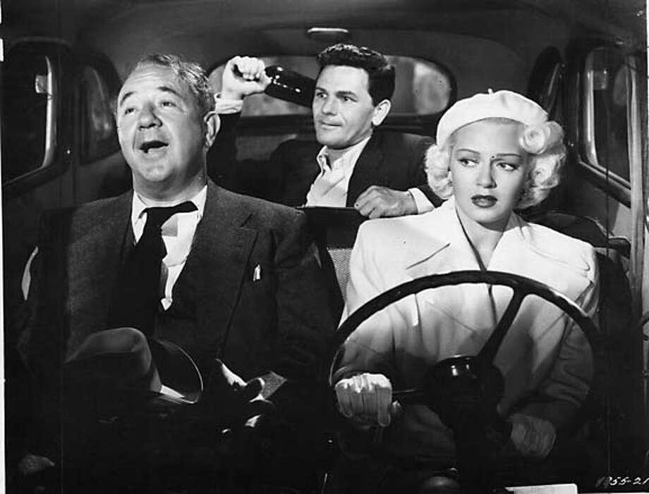 """Cecil Kellaway, John Garfield and Lana Turner in """"The Postman Always Rings Twice.''"""