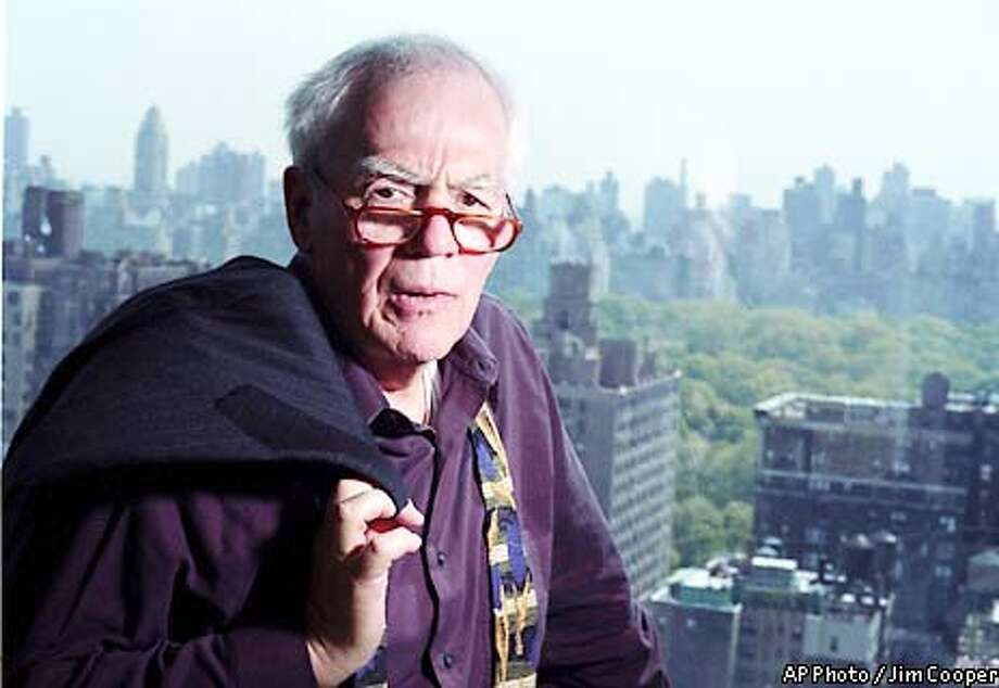 ** ADVANCE FOR SUNDAY, MAY 26 **Columnist Jimmy Breslin poses in his New York apartment May 7, 2002. Thirty-nine years after his first story appeared in the New York Herald Tribune, a Page One piece on the Mets, their four-game winning streak and their bungling first baseman, Marvelous Marvin Throneberry, he's still writing columns, three a week, but now for Newsday. (AP Photo/Jim Cooper) Photo: JIM COOPER