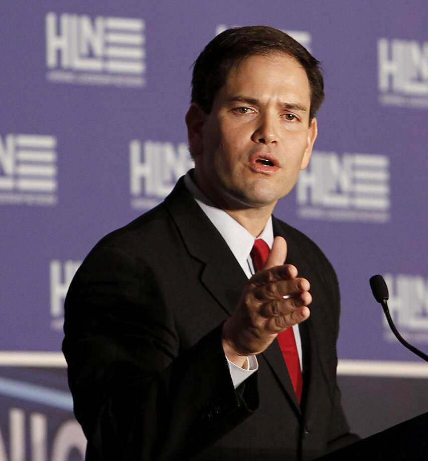 Sen. Marco Rubio, R-Fla., talks to guests during the Hispanic Leadership Network in Miami, Friday, Jan. 27, 2012. (AP Photo/Alan Diaz) Photo: Alan Diaz, Associated Press