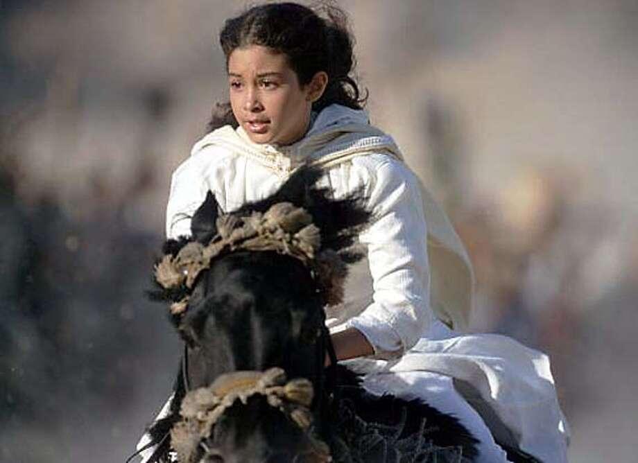 "imax11-b.jpg / for: Sunday Datebook slug: imax11; Scenes from the movie ""Young Black Stallion'' / HO"