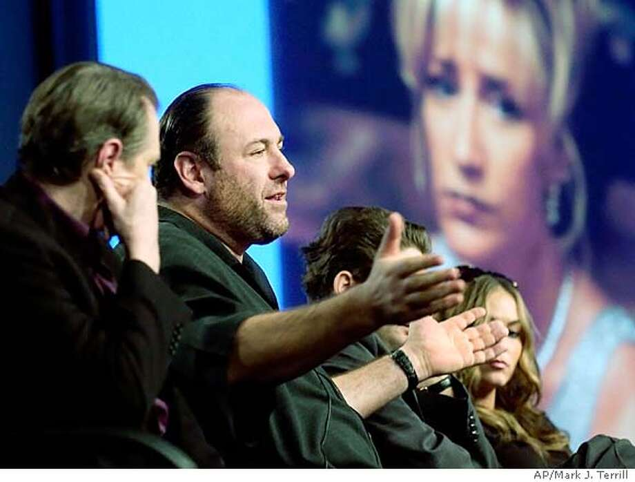 Actor James Gandolfini, who plays Tony Soprano, speaks during the TCA Press Tour, Thursday, Jan. 8, 2004, in Los Angeles. In the background is a picture of Edie Falco, who plays Carmela Soprano. Falco participated via phone. The new season begins March 7. (AP Photo/Mark J. Terrill) Photo: MARK J. TERRILL