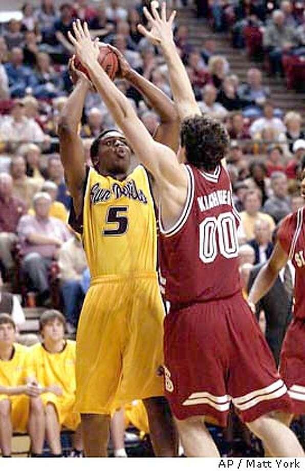 Arizona State's Ike Diogu, rear, shoots over Stanford's Joe Kirchofer during the second half Thursday, Jan. 8, 2004 in Tempe, Ariz. Stanford won 63-62.(AP Photo/Matt York) Photo: MATT YORK