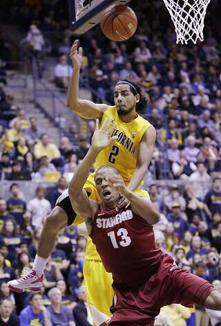 California guard Jorge Gutierrez (2) intentionally fouls Stanford forward Josh Owens (13) in the first half of an NCAA college basketball game in Berkeley, Calif., Sunday, Jan. 29, 2012. (AP Photo/Paul Sakuma) Photo: Paul Sakuma, Associated Press