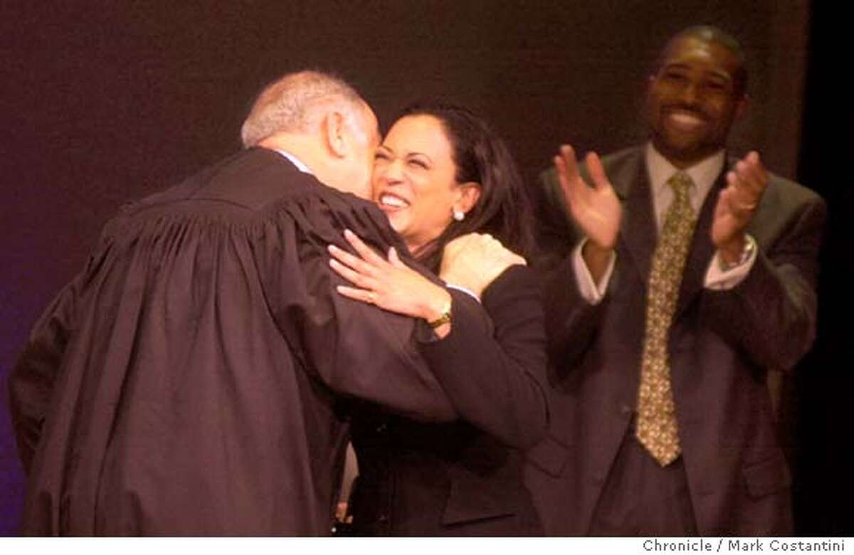 Photo taken on 1/8/04 in SAN FRANCISCO. Newly sworn-in San Francisco District Attorney Kamala Harris is hugged by Chief Justice Ronald M. George of the California Supreme Court at her swearing in ceremony at Herbst Theater. At right is Harris' brother in law, Tony West. CHRONICLE PHOTO BY MARK COSTANTINI
