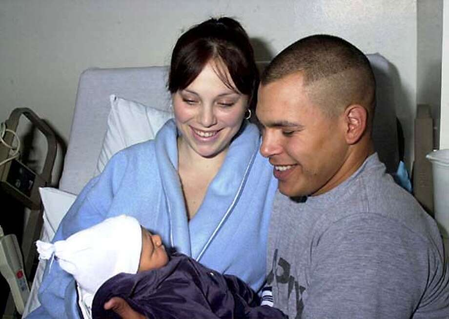 Pfc. Jesse Mizener, shown with his wife, Nicole, and newborn son Jesse Jr. in November, had told his wife he was worried about the increasing mortar attacks. Auburn Journal photo by Karina Williams via Associated Press
