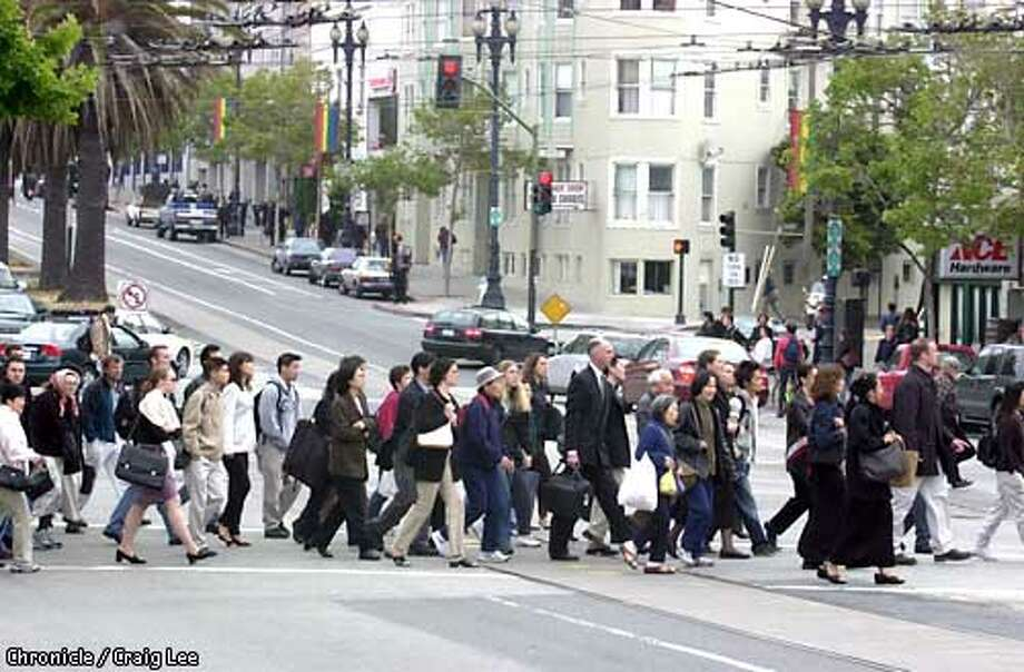 Underground Muni along Market street is temporarily stopped due to a power failure. This causes people crowded on Market street above waiting for buses. Photo of swarms of people crossing Market at Church streets to catch a bus.  Photo by Craig Lee/San Francisco Chronicle Photo: CRAIG LEE