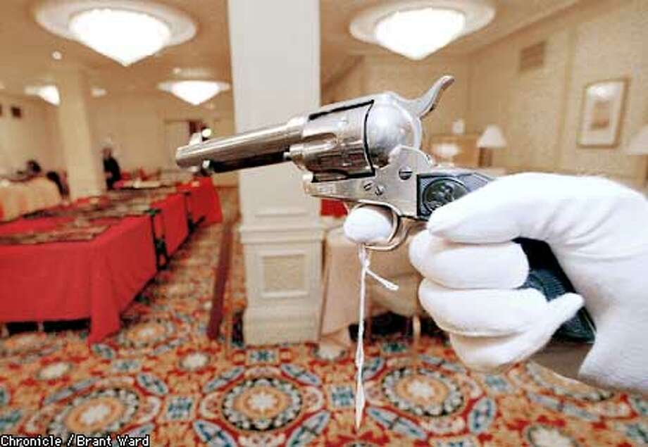 """A rare and historic colt single action army revolver shipped to gunfighter """"Bat"""" Masterson in the 1800s. It sold at auction Monday for $190,000. By Brant Ward/Chronicle Photo: BRANT WARD"""
