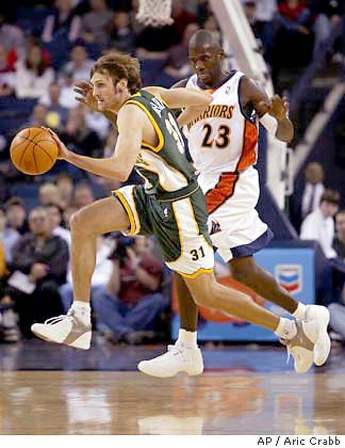 Seattle SuperSonics' Brent Barry (31) drives past Golden State Warriors' Jason Richardson (23) during the first quarter Saturday, Jan. 10, 2004, in Oakland, Calif. (AP Photo/Aric Crabb) Photo: ARIC CRABB