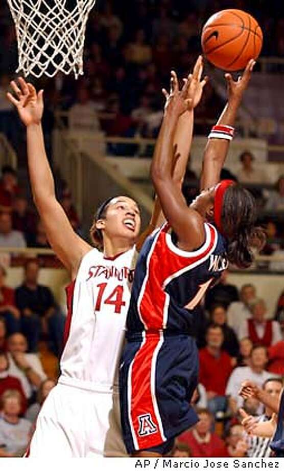 Stanford's Nicole Powell (14) defends as Arizona's Dee Dee Wheeler shoots during the first half Saturday, Jan. 10, 2004, in Stanford, Calif. (AP Photo/Marcio Jose Sanchez) Photo: MARCIO JOSE SANCHEZ
