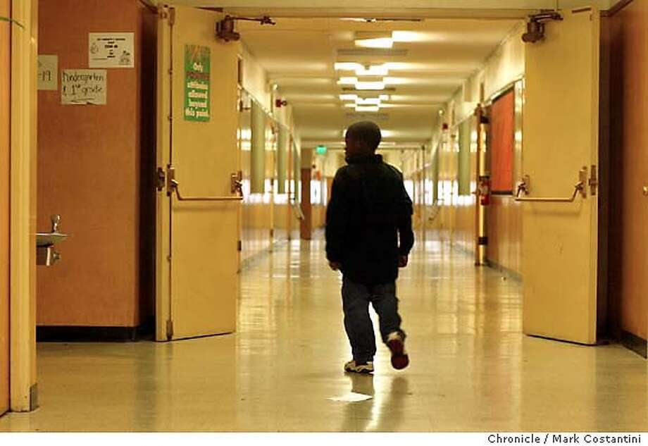 oakskuls003_mac.jpg 2nd grader Curtis Ross has been going to Longfellow school since his pre-school days. Longfellow now on the list of schools that are closing. State Administrator Dr. Randolf E. Ward today announced a shortlist of five Oakland Elemetary schools that face closure. Event on 1/9/04 in . / The Chronicle Photo: Michael Macor