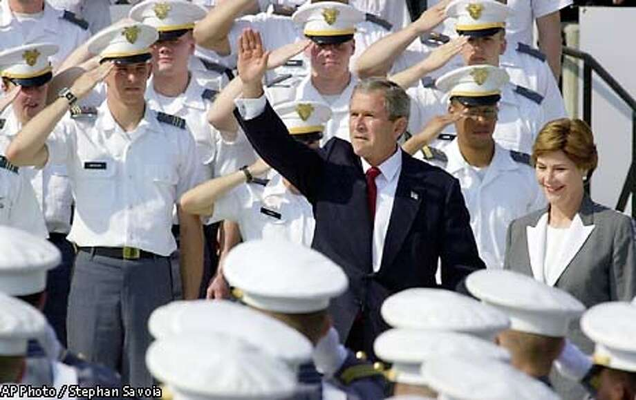 President Bush and first lady Laura Bush receive salutes from cadets as they enter the football stadium at the United States Military Academy at West Point at the start of the school's 200th commencement ceremony in West Point, N.Y., Saturday morning June 1, 2002. (AP Photo/Stephan Savoia) Photo: STEPHAN SAVOIA
