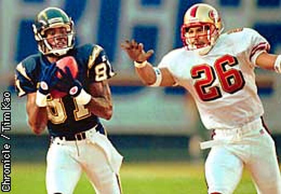 San Diego Chargers' Tony Martin pulls in a pass after beating San Francisco 49ers Rod Woodson (26) during the first quarter of a preseason game Saturday, Aug. 2, 1997, in San Diego. The play was good for a 31-yard gain. (AP Photo/Lenny Ignelzi) Photo: LENNY IGNELZI