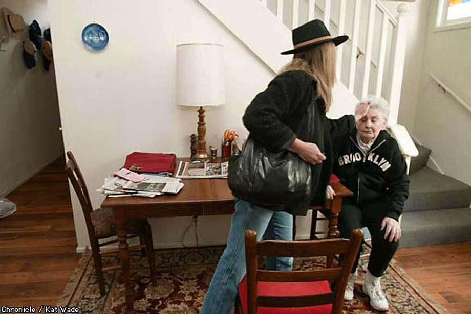 Out and about: Jan Sluizer touches up her mother, Shirley Sluizer's, hair before taking her for bi-monthly trip to have her nails done and to eat out. Chronicle photo by Kat Wade