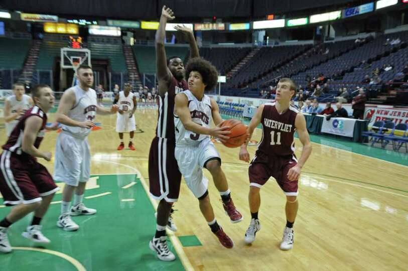 Lansingburgh's Dante Carr drives to the basekt during Watervliet's 50-46 victory at the Times Union
