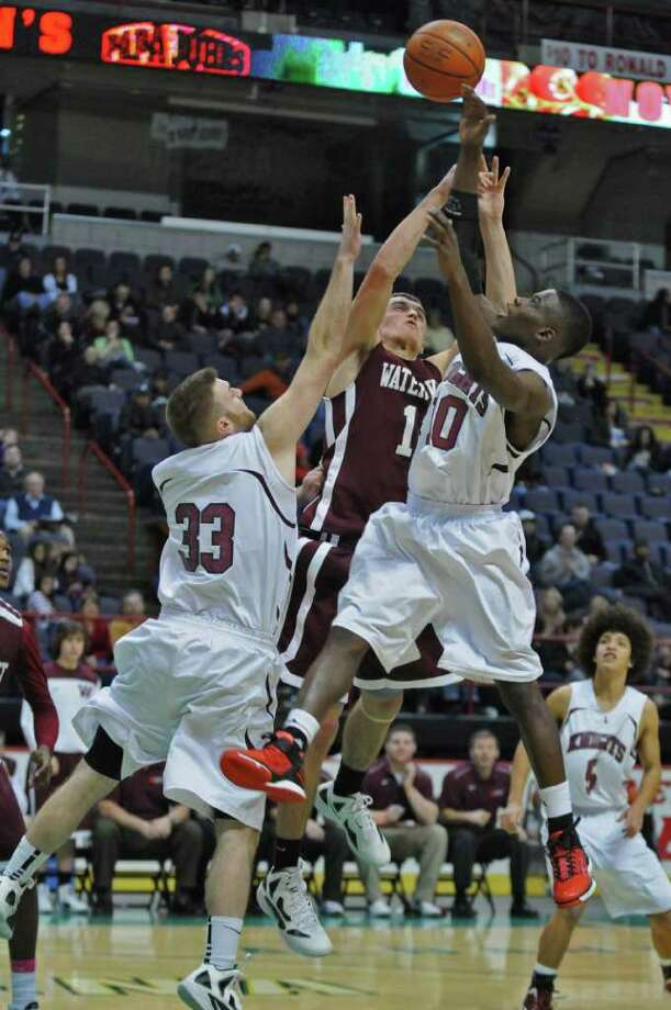 Lansingburgh's Jacob Schongar, left, and Raheem Felder, right,  battle Watervliet's Griffin Kelly, center, during Watervliet's 50-46 victory at the Times Union Center on Sunday Jan. 29, 2012 in Albany, NY.  (Philip Kamrass / Times Union ) Photo: Philip Kamrass / 00016238A