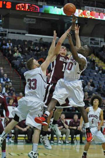 Lansingburgh's Jacob Schongar, left, and Raheem Felder, right,  battle Watervliet's Griffin Kelly, c