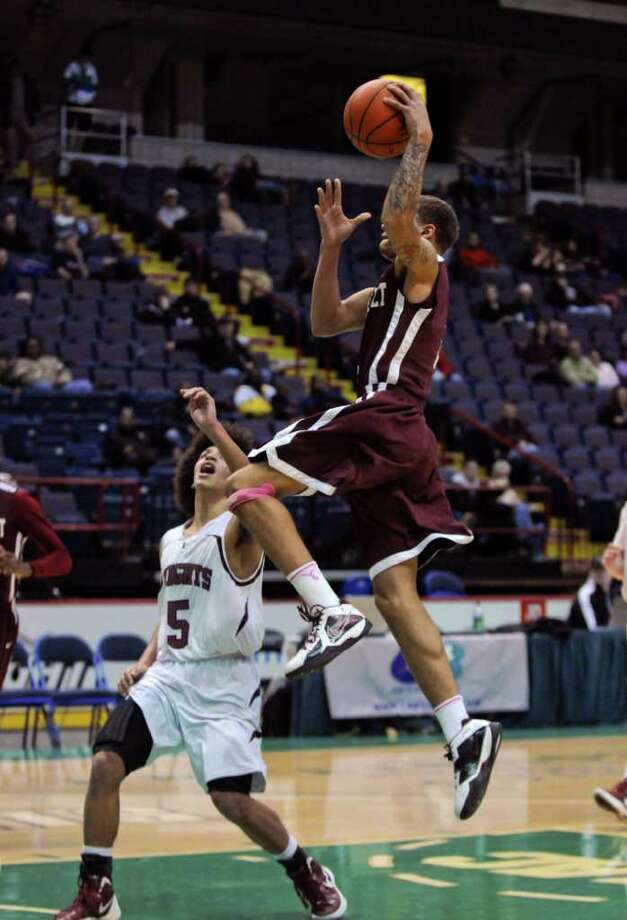 Watervliet's Jordan Gleason drives to the basket during their 50-46 victory, while Lansingburgh's Dante Carr defends, at the Times Union Center on Sunday Jan. 29, 2012 in Albany, NY.  (Philip Kamrass / Times Union ) Photo: Philip Kamrass / 00016238A