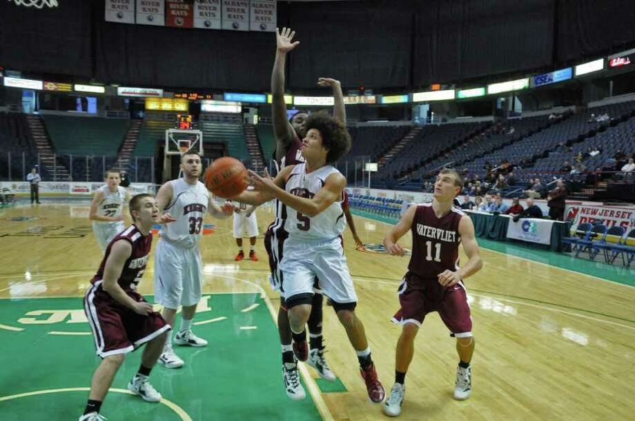 Lansingburgh's Dante Carr drives to the basekt during Watervliet's 50-46 victory at the Times Union Center on Sunday Jan. 29, 2012 in Albany, NY.  (Philip Kamrass / Times Union ) Photo: Philip Kamrass / 00016238A