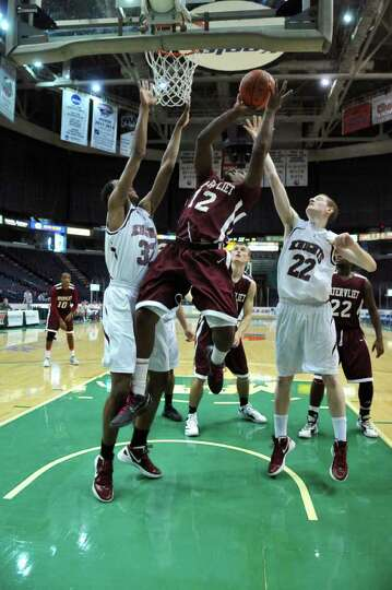 Lansingburgh's Malik Miller, left, and Adam Burker, right, defens Watervliet's Antoine Johnson as he