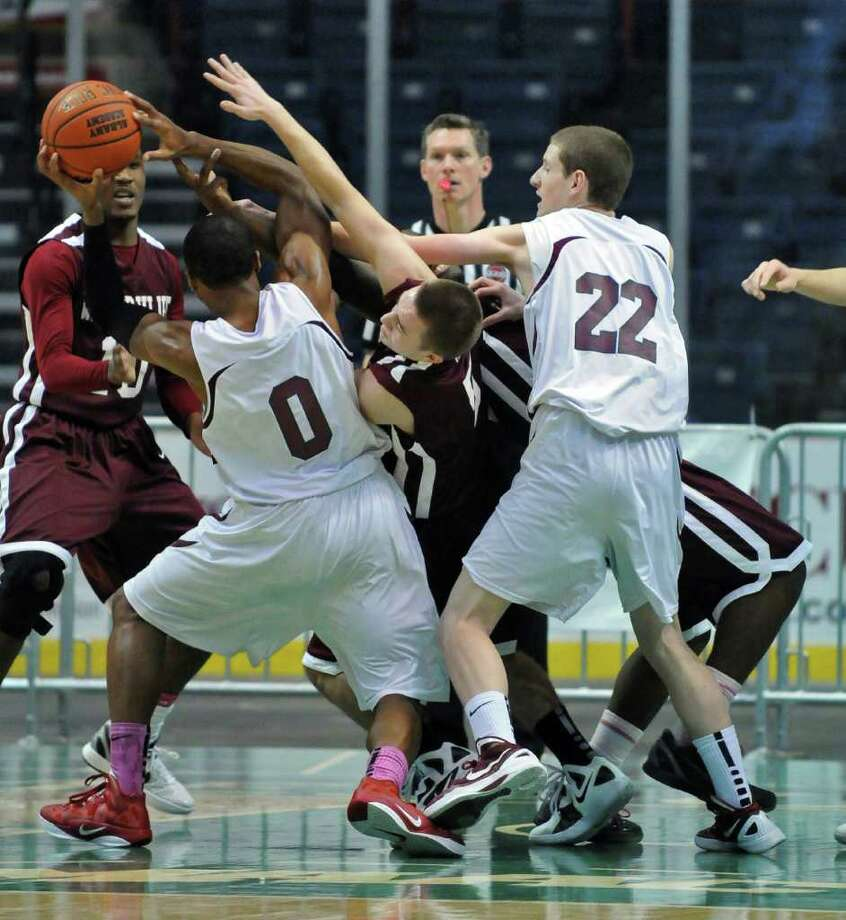 Lansingburgh's Ohmeire Jones handles the ball during Watervliet's 50-46 victory at the Times Union Center on Sunday Jan. 29, 2012 in Albany, NY.  (Philip Kamrass / Times Union ) Photo: Philip Kamrass / 00016238A