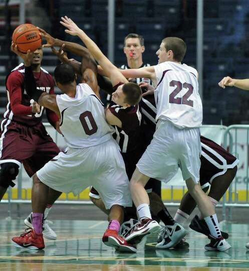 Lansingburgh's Ohmeire Jones handles the ball during Watervliet's 50-46 victory at the Times Union C