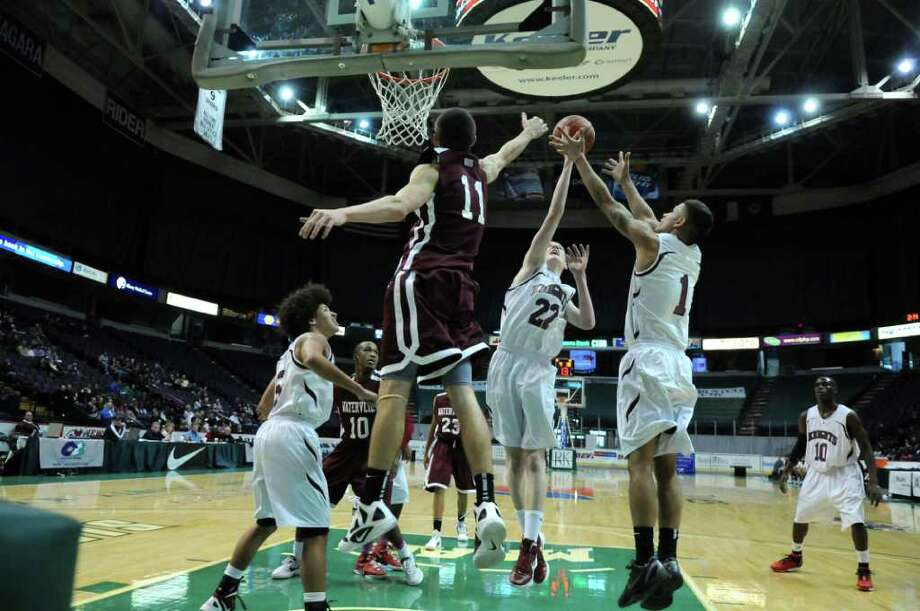 Lansingburgh's Adam Burke, and  R. Carlo Grillo, right, and Watervliet's Griffin Kelly, #11, go for the the ball during Watervliet's 50-46 victory at the Times Union Center on Sunday Jan. 29, 2012 in Albany, NY.  (Philip Kamrass / Times Union ) Photo: Philip Kamrass / 00016238A