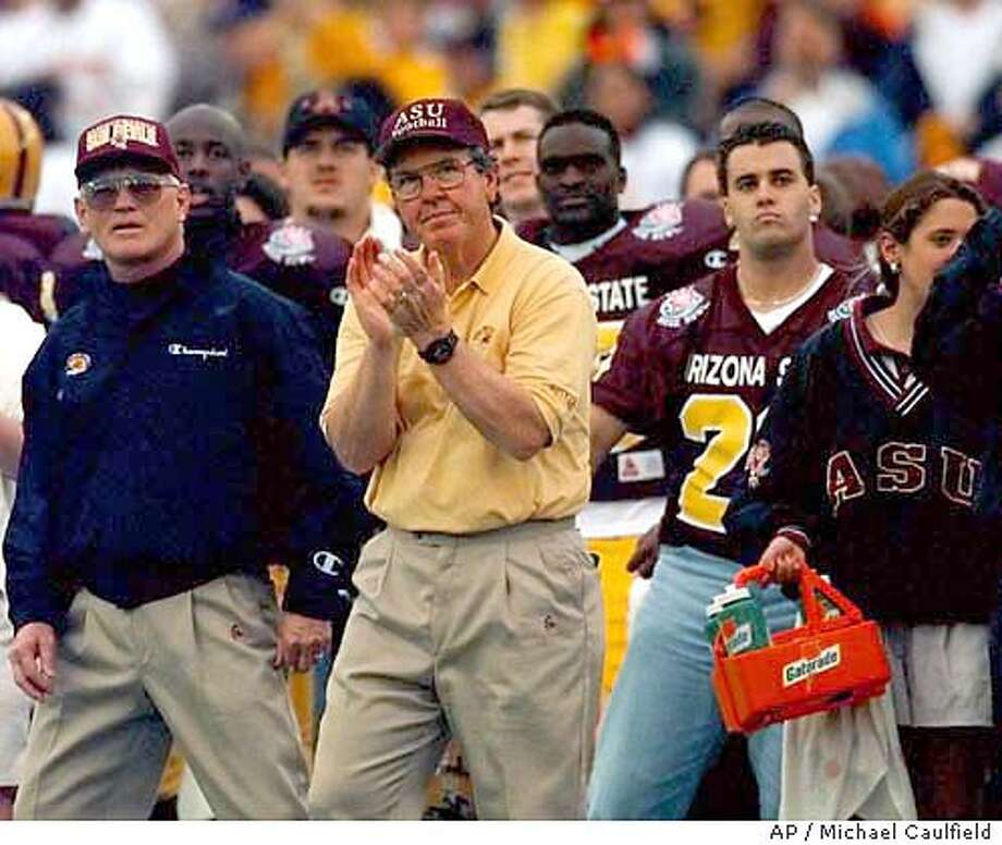 Arizona State coach Bruce Snyder applauds his teams efforts in the second quarter at the 83rd annual Rose Bowl in Pasadena, Calif., Wednesday, Jan. 1, 1997. (AP Photo/Michael Caulfield) ELECTRONIC CAMERA IMAGE Photo: MICHAEL CAULFIELD