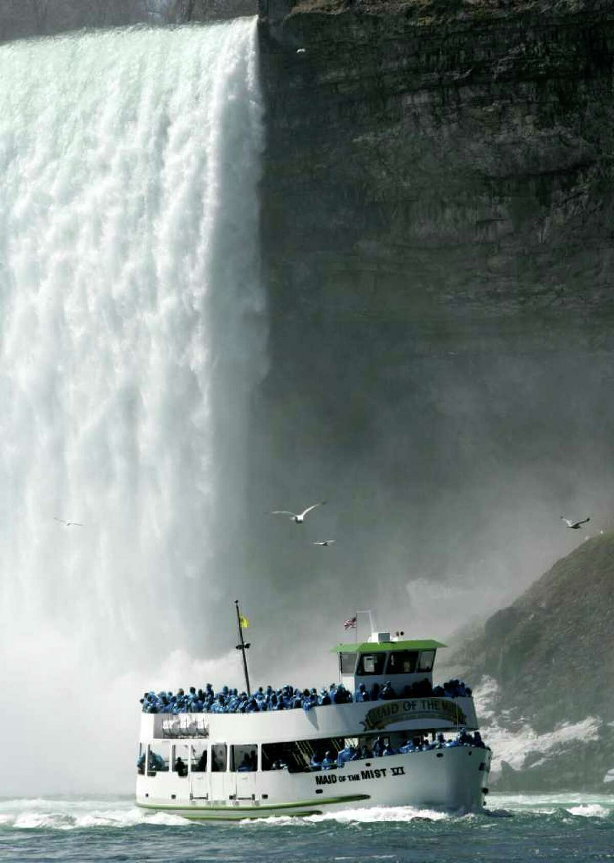 FILE - In this April 21, 2005 file photo, a Maid of the Mist ship returns from the base of the Horseshoe Falls, as seen from a ship leaving Niagara Falls, N.Y. (AP Photo/David Duprey, File)