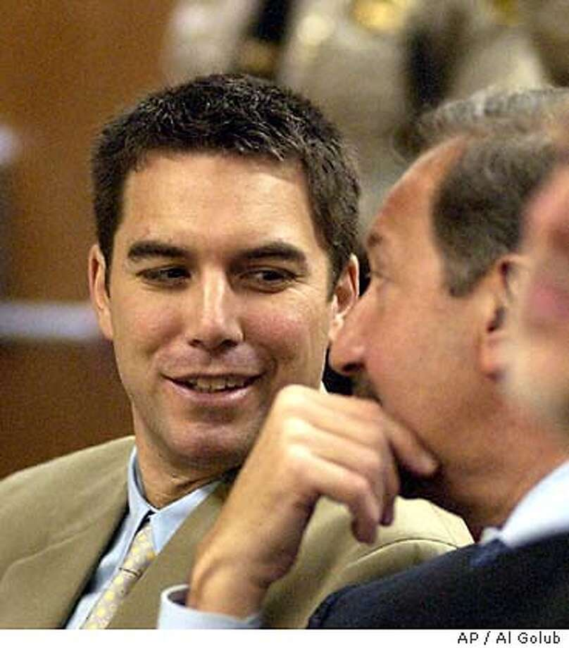 Scott Peterson, left, confers with his attorney Mark Geragos during a hearing in Stanislaus County Superior Court in Modesto, Calif., Thursday, Jan. 8, 2004. Judge Al Girolami ruled Thursday that extensive news coverage swayed him to agree with the defense that Peterson could not get a fair trial in Modesto and ordered the case moved out of Stanislaus County. Peterson, 31, is charged with two counts of murder in the killings of his pregnant wife, Laci Peterson, and unborn son. Prosecutors are seeking the death penalty. (AP Photo/Al Golub, Pool) POOL IMAGE THE MODESTO BEE/AL GOLUB Photo: AL GOLUB