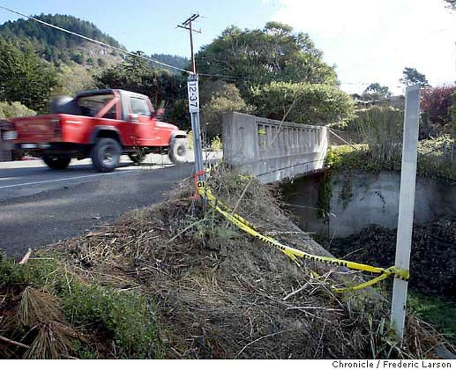 ; Missing a guard fence over a 10 foot embankment on two lane overpass in Stinson Beach. Tipster said someone removed the wire that used to be there and now there are just two posts and some dangling caution tape. There is no curb so there is nothing to slow a car or a person who misses the road. It is directly across from the Fire station. FREDERIC LARSON / The Chronicle Photo: FREDERIC LARSON