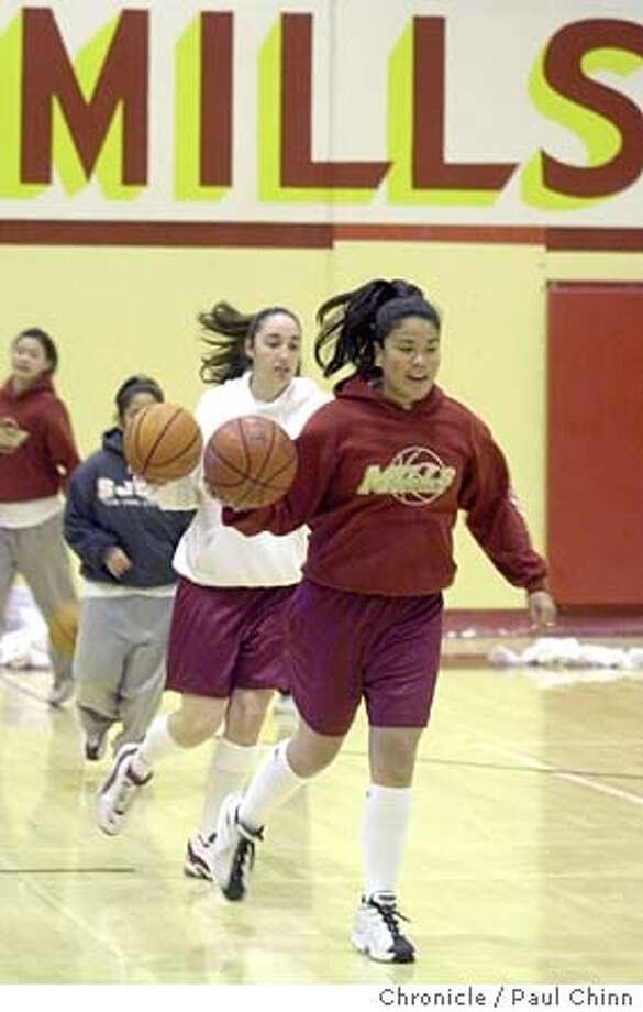 pnmills010_pc.jpg Senior Marissa Gutierrez (front) leads teammates in a dribbling drill. Mills High School girls basketball team practice in Millbrae on 1/2/04. PAUL CHINN / The Chronicle Photo: PAUL CHINN