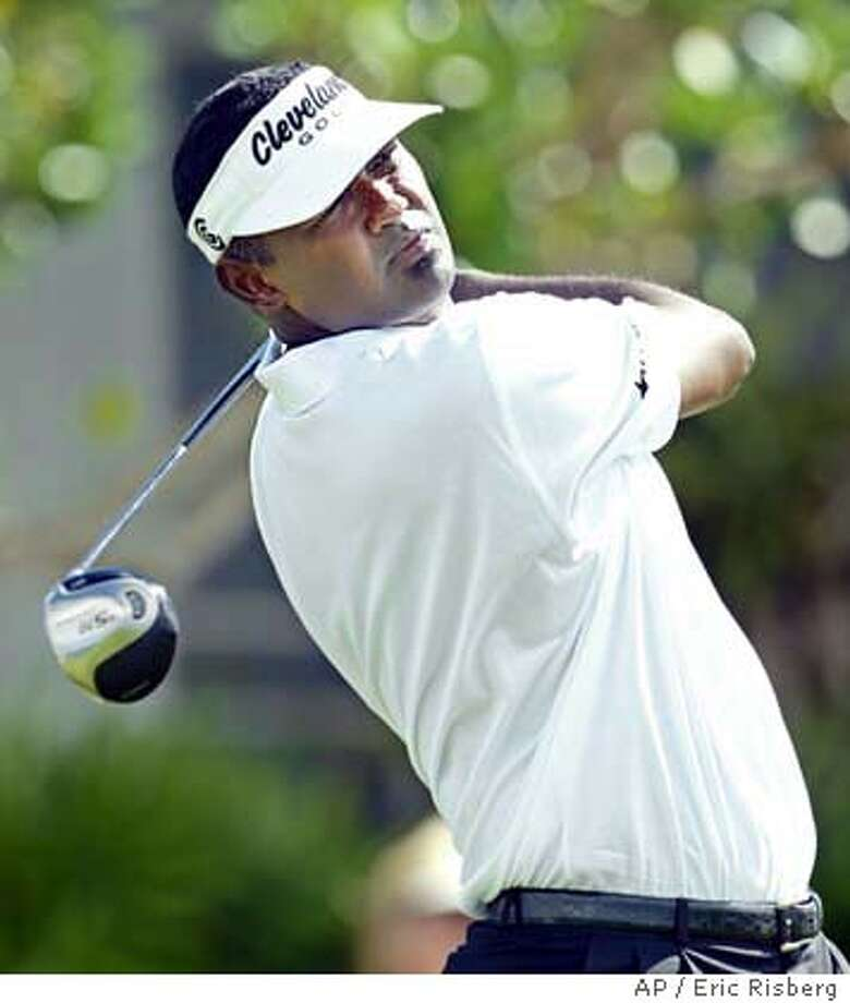 Vijay Singh follows his drive from the 1st tee of the Plantation Course during the second round of the Mercedes Championships in Kapalua, Hawaii, Friday, Jan. 9, 2004. Singh leads the tournament by one stroke after shooting a 9-under-par 64 to finish at total 14-under-par.(AP Photo/Eric Risberg) Photo: ERIC RISBERG