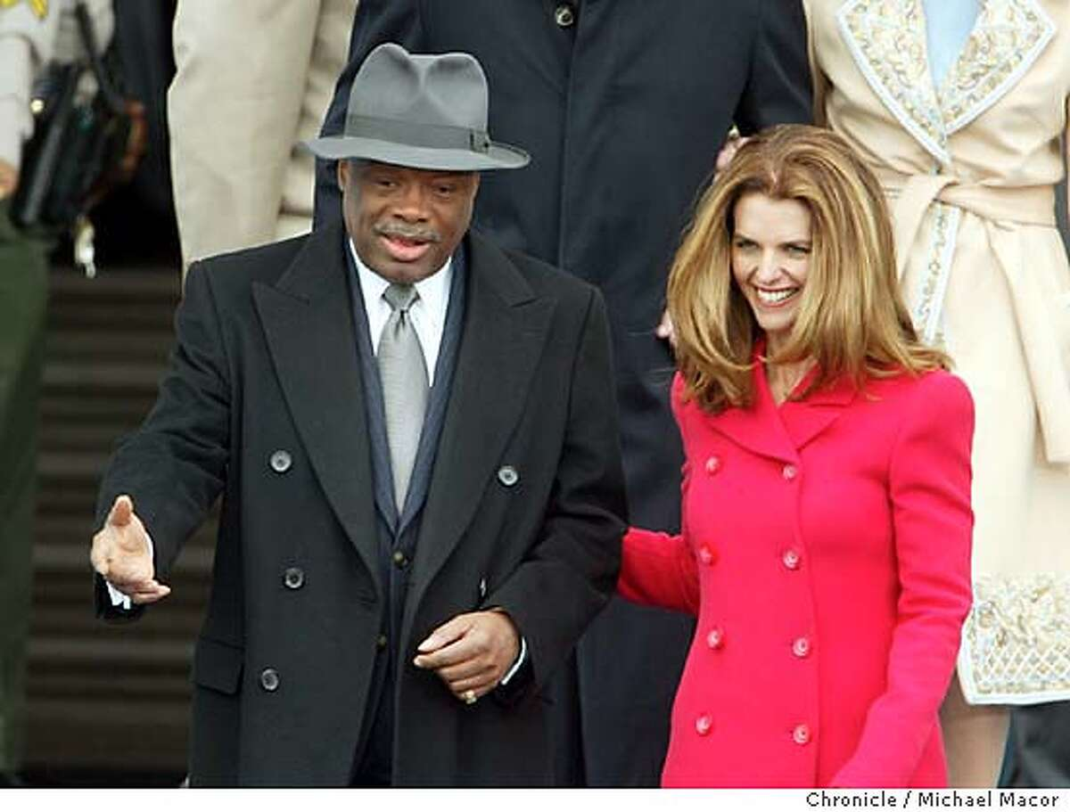 newsome124_mac.jpg First Lady of the State of California, Maria Shriver escorts outgoing Mayor Willie Brown to his seat for the inaugural. The Inauguration of Gavin Newsom the next Mayor of San Francisco. Michael Macor/ The Chronicle on 1/8/04 MANDATORY CREDIT FOR PHOTOG AND SF CHRONICLE/ -MAGS OUT