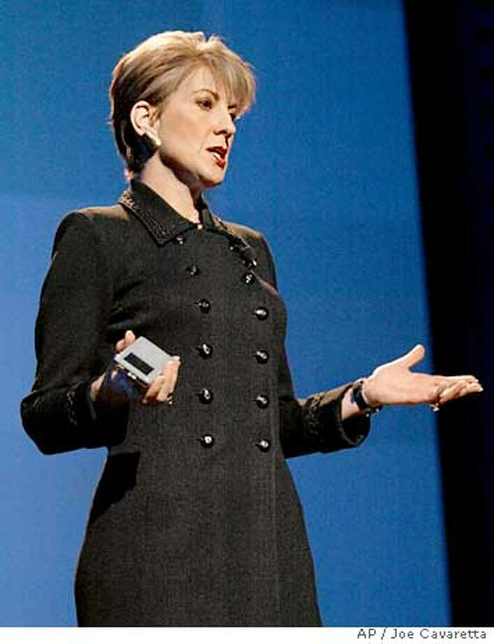 Carly Fiorina, Chairman and CEO of HP, holds an HP iPod during a keynote address of the Consumer Electronics Show at the Las Vegas Convention Center Hilton Hotel Thursday, Jan. 8, 2004. HP announced a partnership with Apple.(AP Photo/Joe Cavaretta) Photo: JOE CAVARETTA