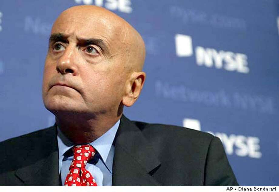 ** FILE ** Dick Grasso, Chairman and CEO of the NYSE, attends a press conference in New York, Tuesday, Sept. 9, 2003, where he discussed a letter sent to the Securites and Exchange Commission regarding his compensation package.The New York Stock Exchange board asked state and federal regulators Thursday, Jan. 8, 2004, to pursue an investigation into how Grasso managed to rack up nearly $200 million in retirement benefits and deferred compensation. (AP Photo/Diane Bondareff) Photo: DIANE BONDAREFF