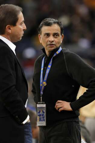 Vivek Ranadive, right, part owner of the Golden State Warriors, is CEO of Tibco Software, and the NBA's first Indian-American owner of a team. Here he speaks with co-owner, Joe Lacob, left, before the Warriors game against the Chicago Bulls on Monday, December 26, 2011 at Oracle Arena in Oakland, Calif. Photo: Carlos Avila Gonzalez, The Chronicle