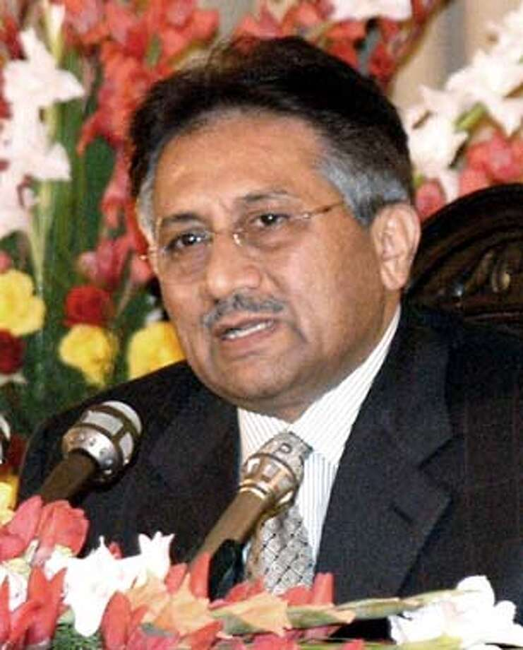 "Pakistani President Pervez Musharraf addresses a news conference at the Presidential palace in Islamabad, Pakistan Tuesday Jan. 6, 2004. Musharraf gave credit for the deal to the ""vision"" and ""statesmanship"" of Indian Prime Minister Atal Bihari Vajpayee. He said the two men sealed the agreement early Tuesday in a phone call following their historic face-to-face meeting a day earlier. (AP Photo/Press Informationa Department, HO)"