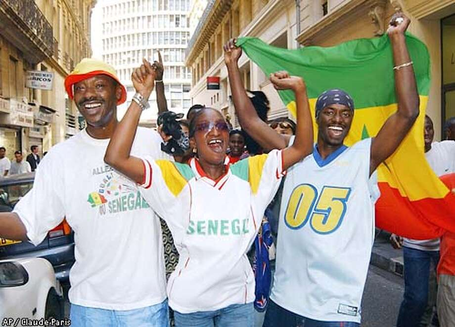 Senegal's supporters celebrate their country's victory over France in central Marseille, southern France, after the soccer World Cup opening game between defending champion France and Senegal, Friday, May 31, 2002. Senegal defeated France 1-0. (AP Photo/Claude Paris) Photo: CLAUDE PARIS