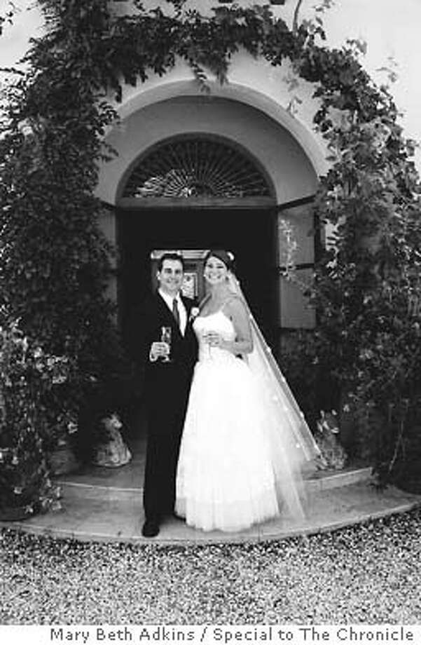/ for: Datebook slug: SOCIAL07; Michael Gregor and Cairo Cebrian tied the knot at the home of Austin and Erika Hills, where the wedding menu was not as spicy as it has been in the past. Mary Beth Adkins / Special To The Chronicle Photo: Mary Beth Adkins